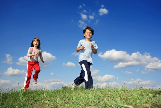 children running in open field