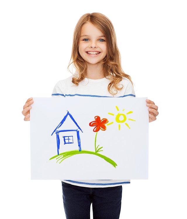 little girl holding artwork