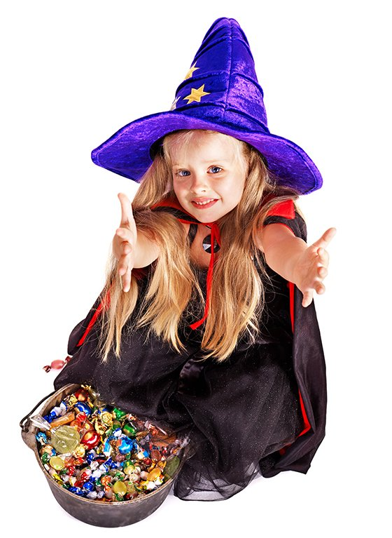 little girl in witches costume