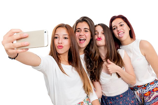 Teen taking selfie