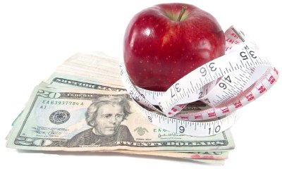 apple measuring tape and money