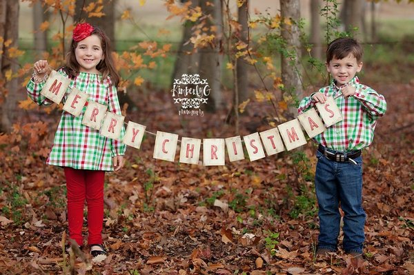 Children with sign Christmas photo