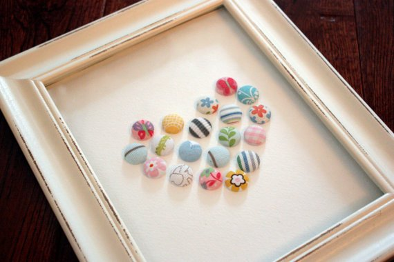 Button art from baby clothing
