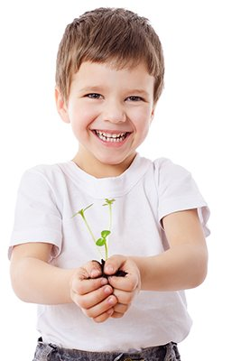boy with plant in his hand