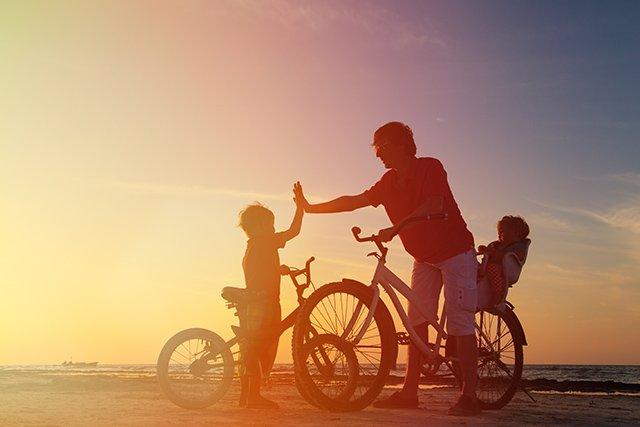 Dad with kids on bike