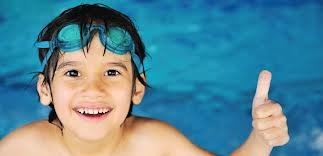 Child swimming thumbs up