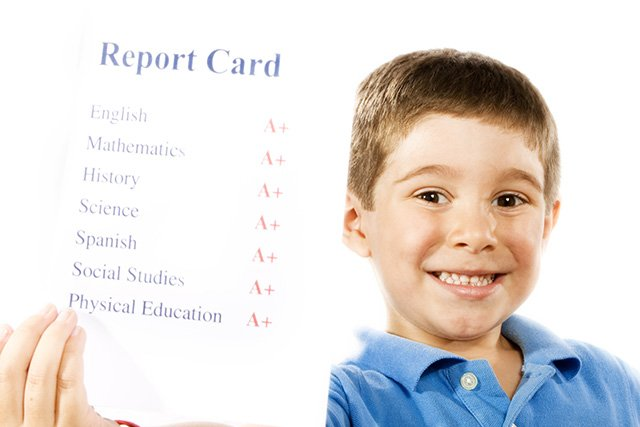 boy with report card