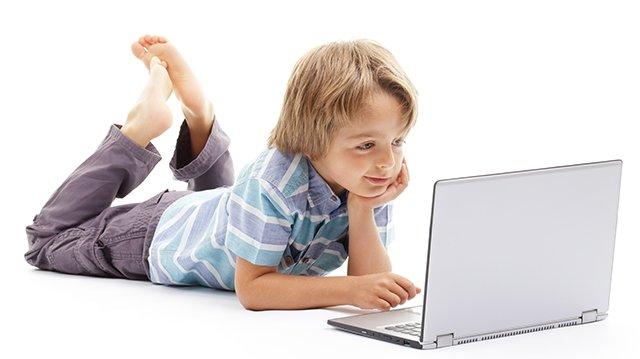 boy on computer isolated