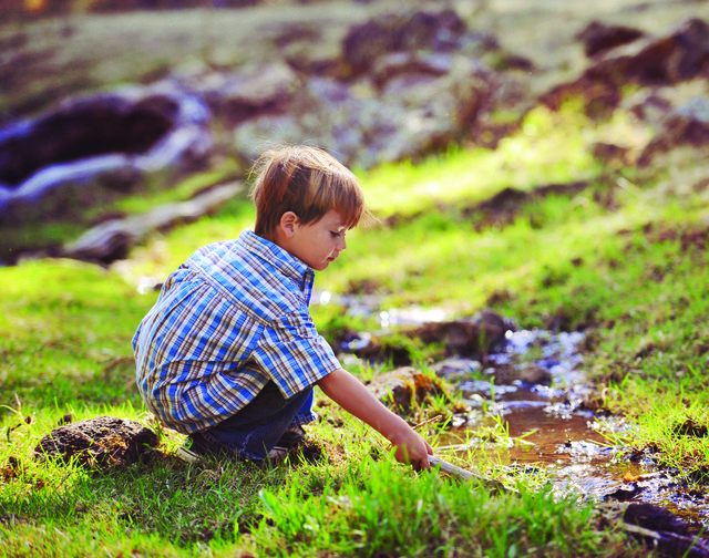boy outside in nature