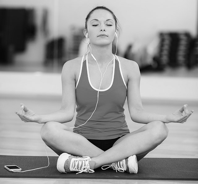 Woman meditating with iPhone