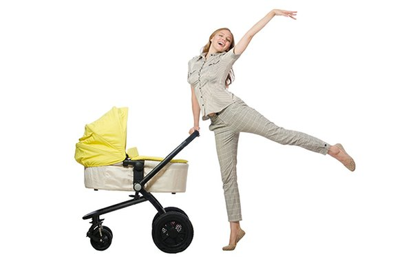 Happy mother with baby in carriage