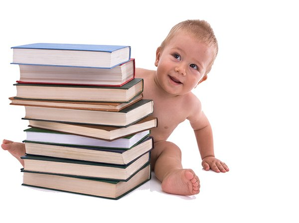 baby behind stacks of books