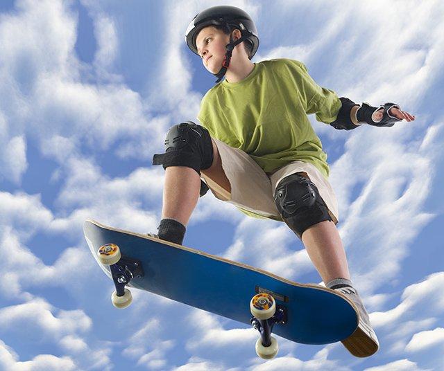 child on skateboard