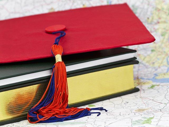 graduation hat and map