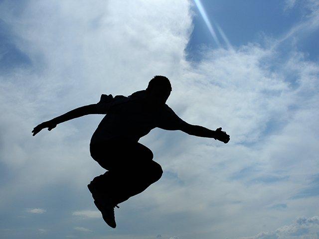 boy on skateboard jumping