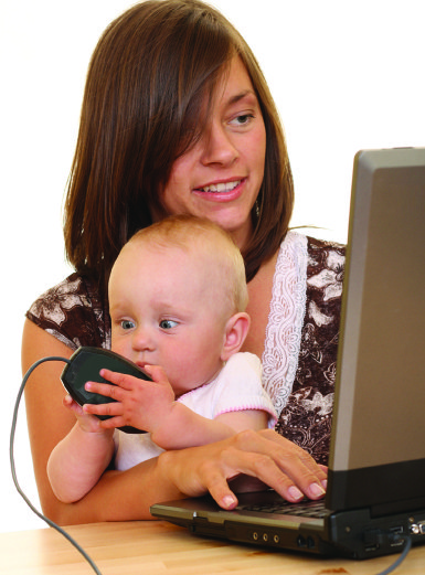 woman at computer with baby