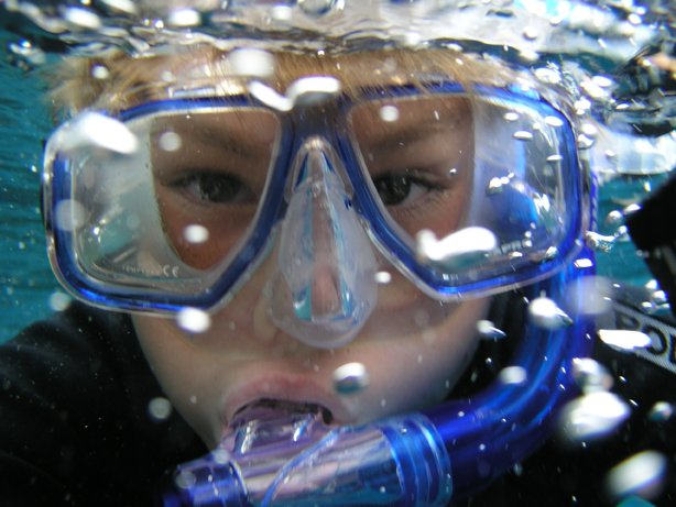 boy swimming in mask