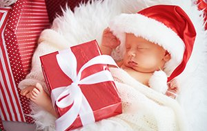 newborn baby in Christmas Santa cap