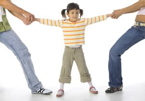 parents pulling arms of girl divorce web.jpg