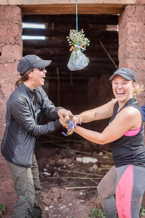 Wellfit Girls Jill Wheeler, Founder, and Avorie Anderson bless the new roof in Peru