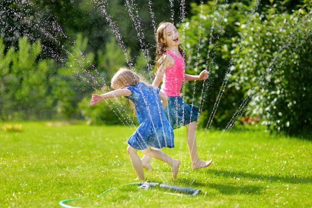 kids running in sprinkler