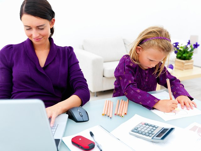 mom working with daughter at computer