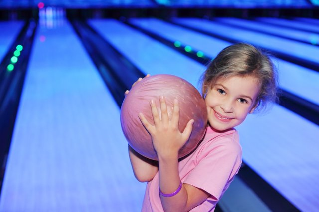 bowling smiling girl alley sports.jpeg