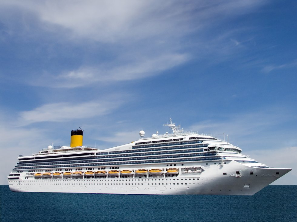 cruise ship against blue water and sky.jpg