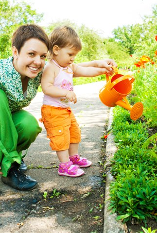 mother gardening with toddler