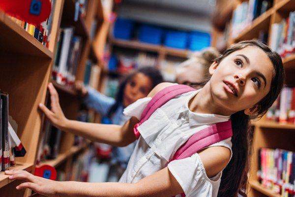 girl library books student school.jpeg