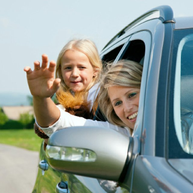 woman waving from car