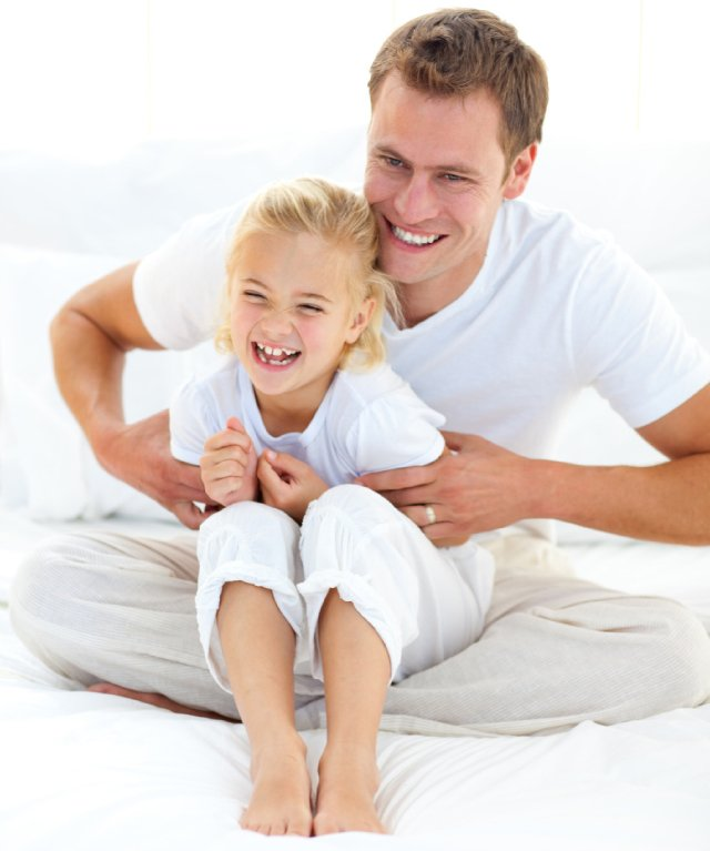 dad playing with daughter