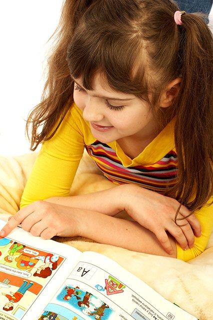 girl reading comic