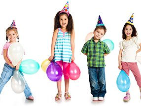 kids in birthday hats