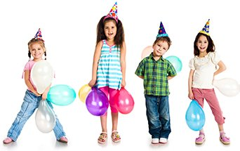 kids in birthday hats