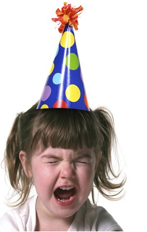 crying child in birthday hat