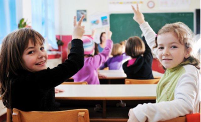 students raising hands in Naples classroom