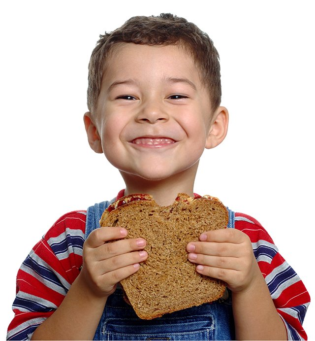 child eating pb&j
