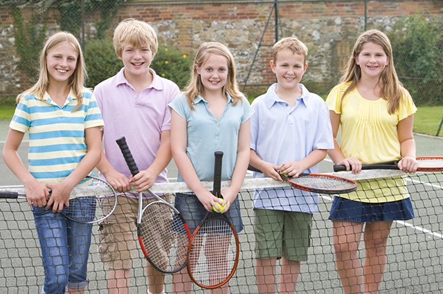 preteens playing tennis