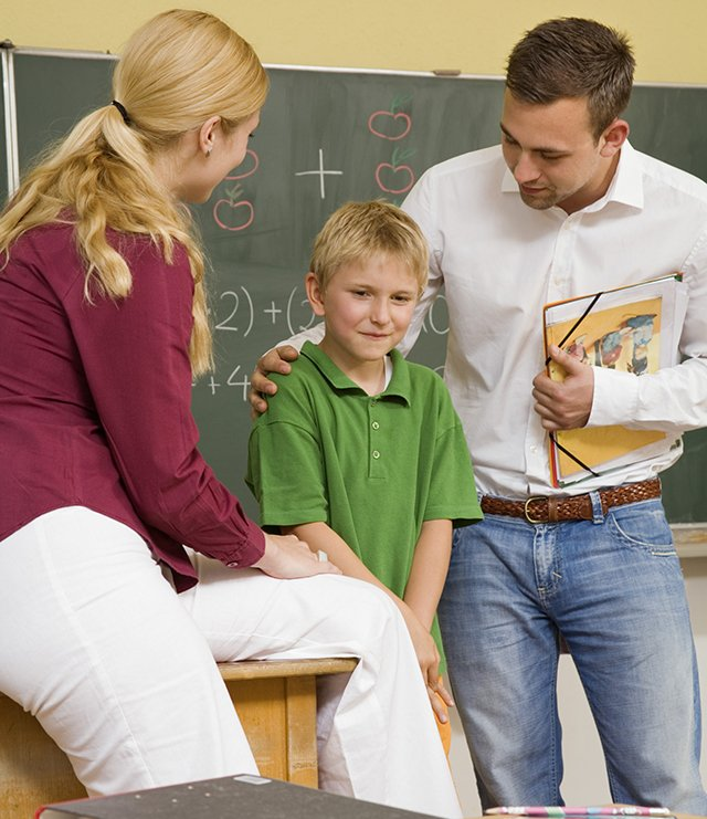 teacher with father and son