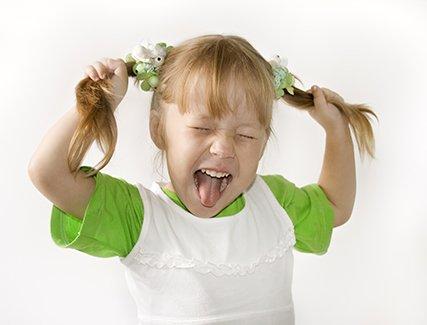 girl pulling pigtails