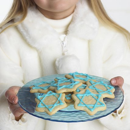 child with Hanukkah cookies on plate.jpg