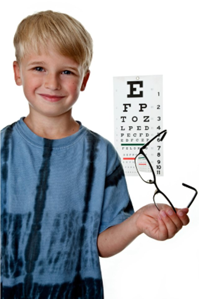 boy getting eyes examined
