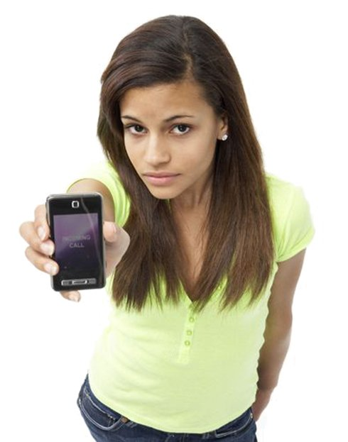 teen girl holding cell phone