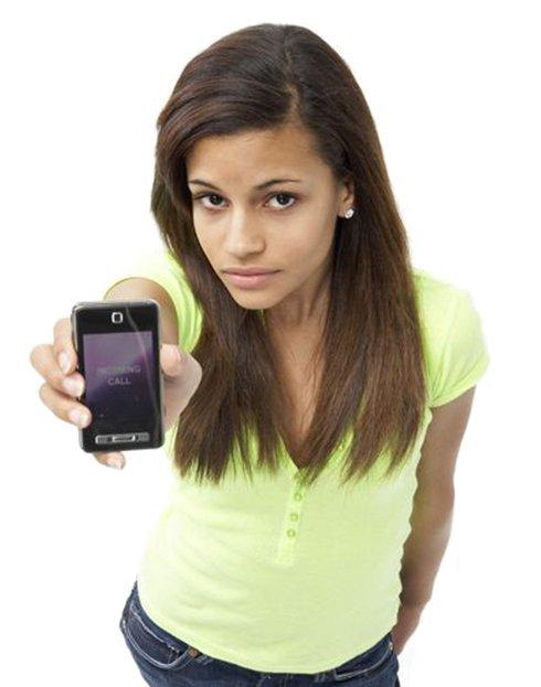 teen girl holding cell phone