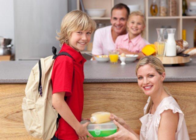 mom giving son school lunch