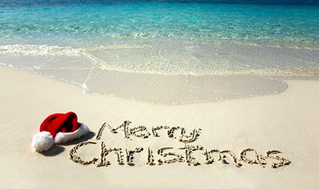 Merry XMas Written in Sand