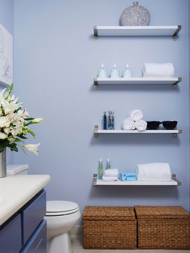 Floating shelves used in small bathroom