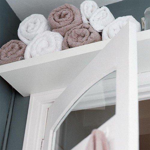shelf above door in bathroom