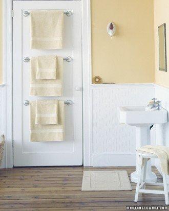 triple towel bars in small bathroom